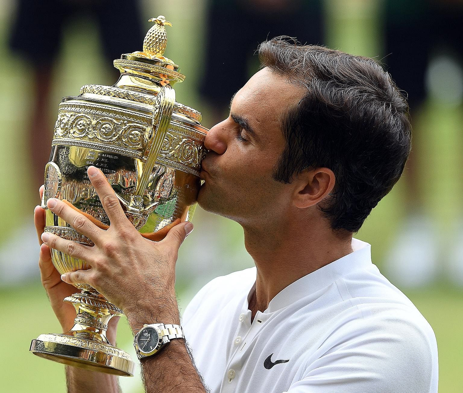 Roger Federer kissing the Wimbledon trophy. With his eighth title at the All England Club, he holds the record for most men's singles crowns alone after sharing it with American Pete Sampras and Briton William Renshaw since 2012.