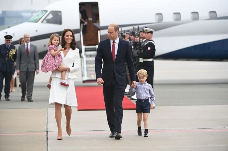 George and Charlotte arrive in rainy Warsaw with William and Kate