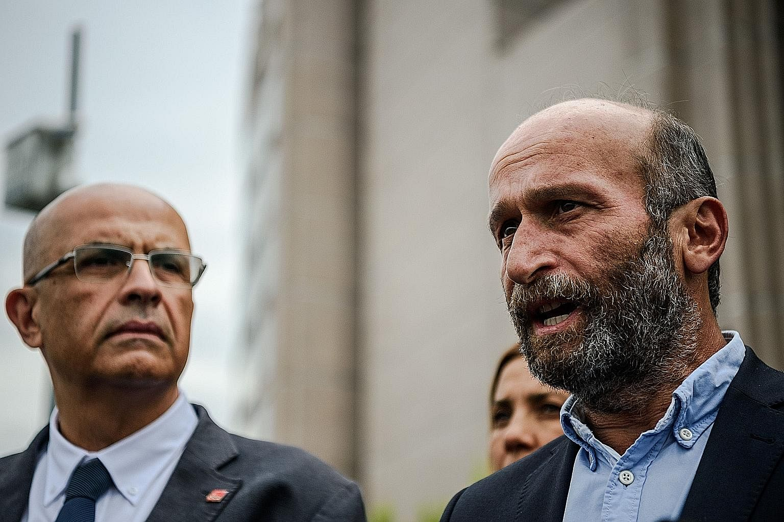 The editorial team of Turkey's oldest newspaper the Cumhuriyet including its Ankara bureau chief Erdem Gul (below, right, with former main opposition MP Enis Berberoglu) is scheduled to face a judge today. They will be defending not only themselves,