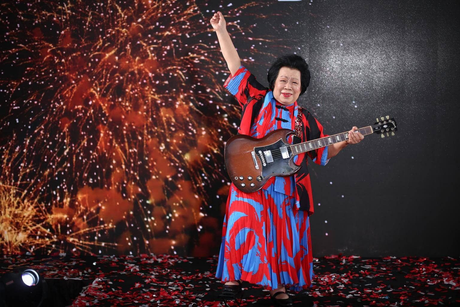Grandma Ho will perform two songs with her guitar at this year's Singapore's National Day Parade. Image: Ong Wee Jin/The Straits Times