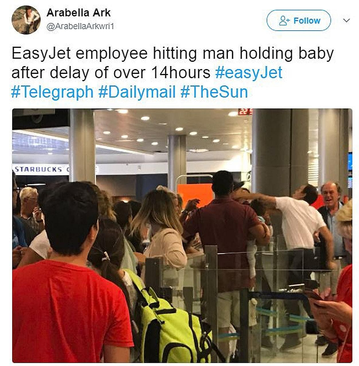 A photo posted by Ms Arabella Arkwright showing an airport worker punching a passenger in the face.