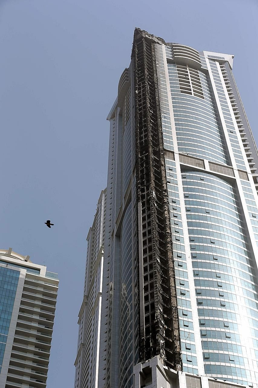 The Torch, one of the tallest towers in Dubai at 337m, after a fire ripped through it early yesterday morning.