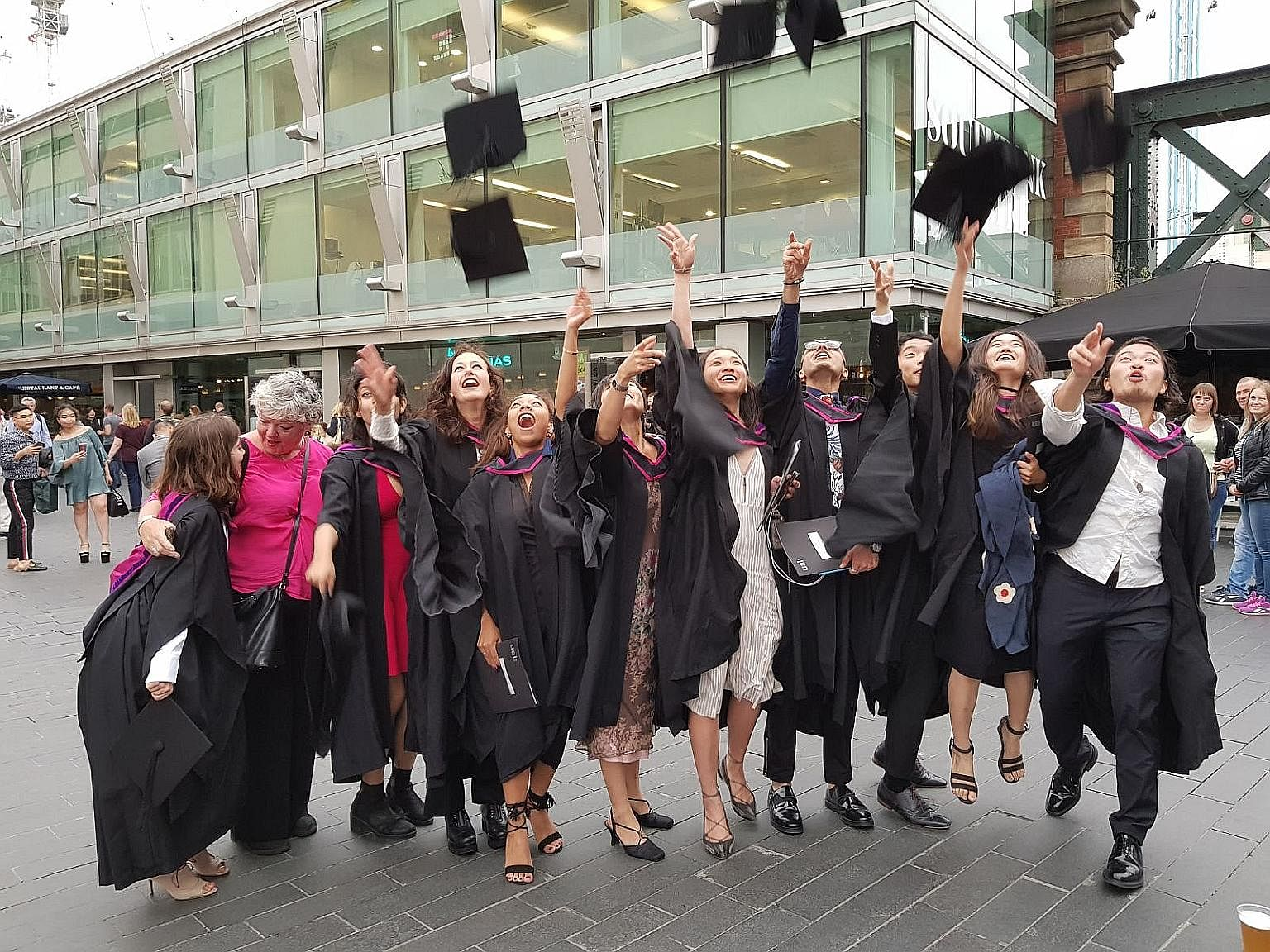 The writer's daughter, Ms Jacelyn Chua (fifth from right), at her graduation ceremony from the London College of Fashion last month. Ms Chua was advised to approach financial planning with a long-term perspective.