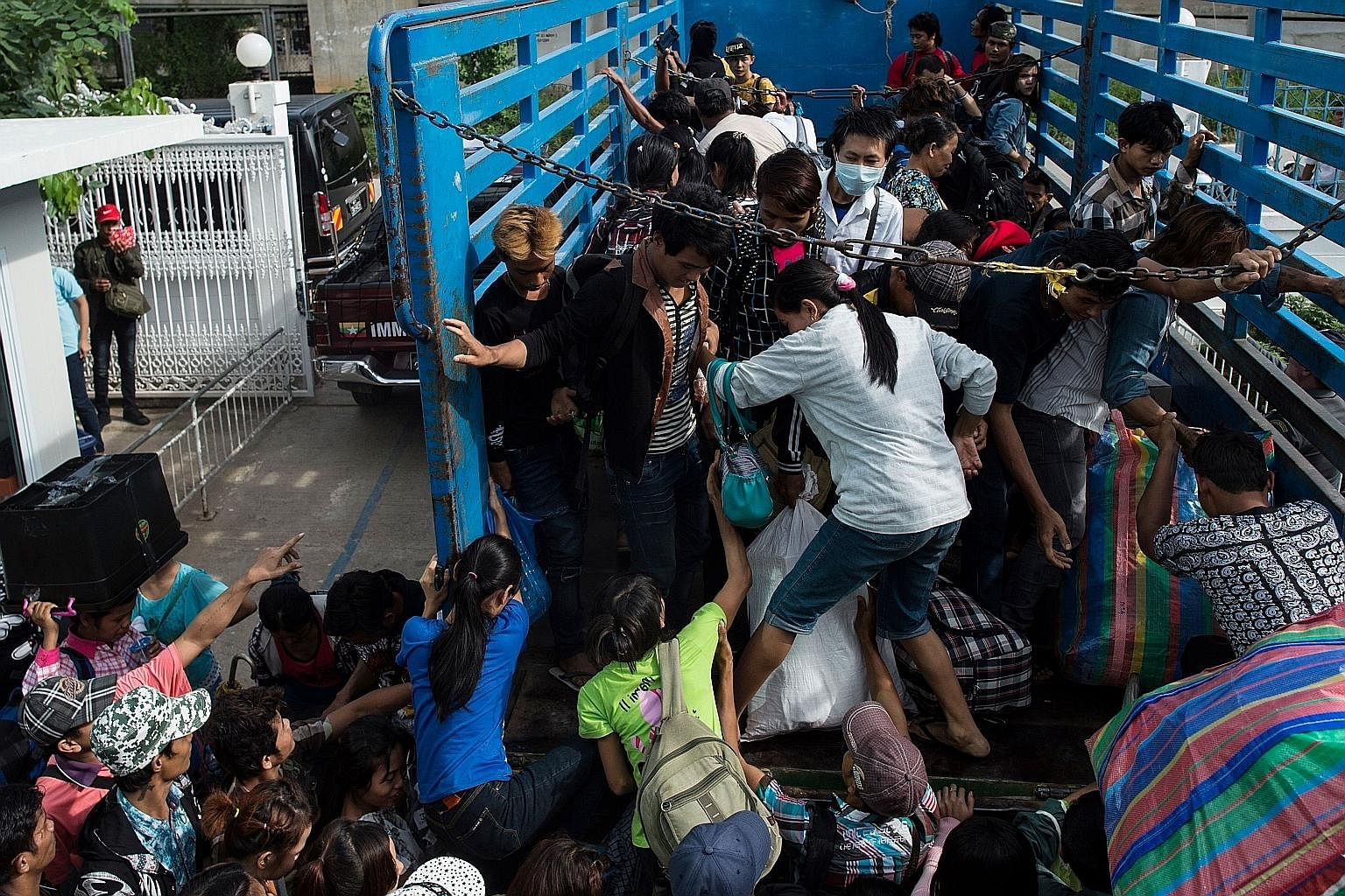 Migrant workers from Myanmar leaving Thailand last month, after Bangkok toughened rules against undocumented workers. The writer says that, going forward, Asean must tap the potential of its low-skilled workers as well.
