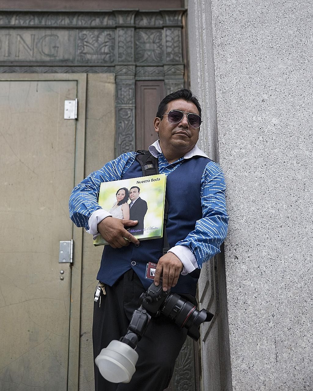 Serbian father-and-son team Nikola and Goran Veljic (above) and Ecuadorian Braulio Cuenca (below) offer photography services outside the City Clerk's Office in Manhattan.
