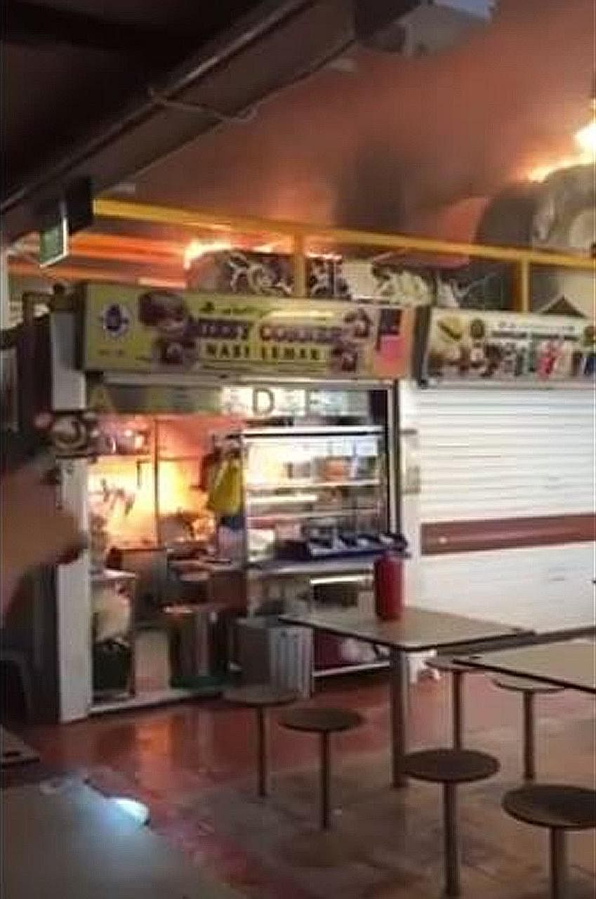 A video was uploaded online showing the fire razing the kitchen stove and exhaust ducting at Mizzy Corner Nasi Lemak at Changi Village.