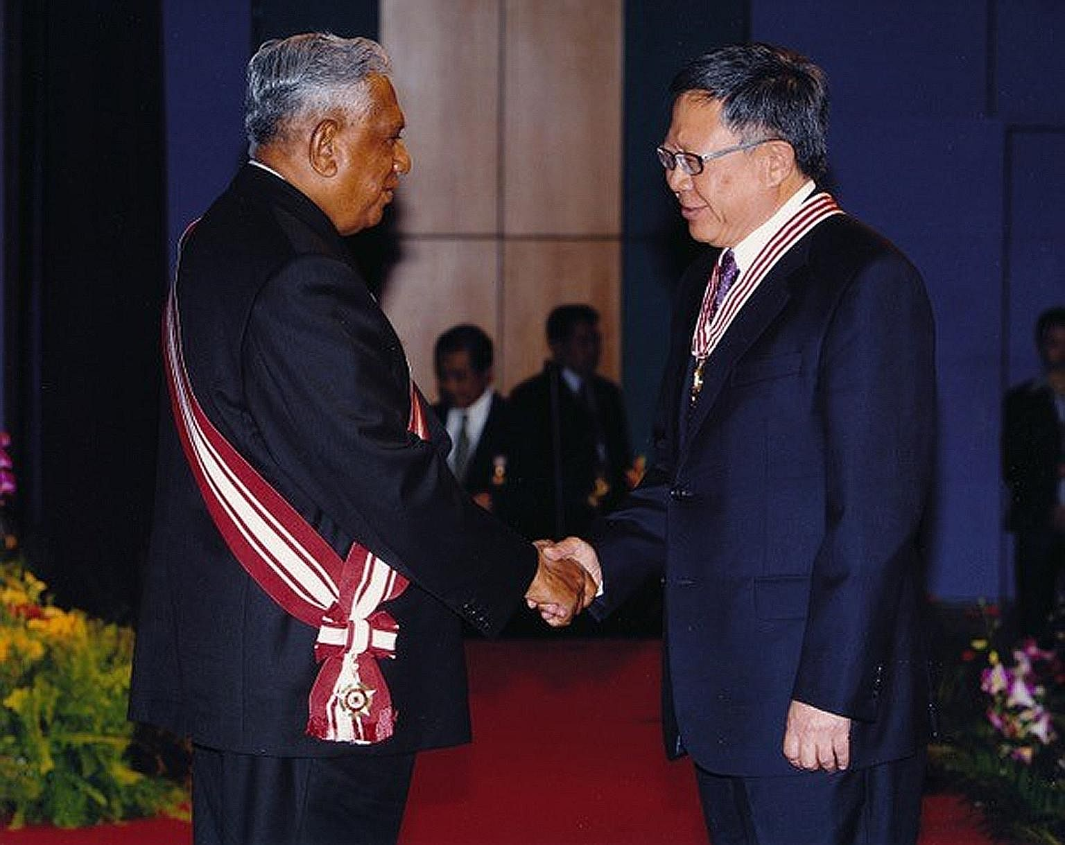 """Mr Eddie Teo receiving the Distinguished Service Order from then President S R Nathan in 2006. Mr Teo, who has been awarded the Order of Nila Utama (First Class) this year, said Mr Nathan """"taught me the values, discipline and instincts required for p"""