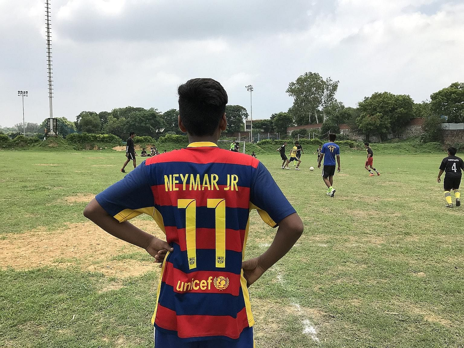 A young player at a tournament organised by the Morning Star Football Academy in Delhi last month. Indian national cricket captain Virat Kohli (far left) and cricketer Umesh Yadav playing football during a practice session in London in June, on the e