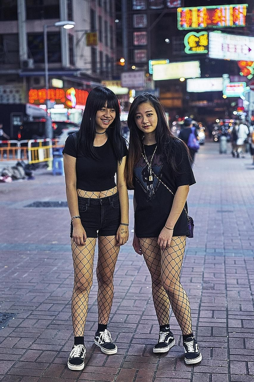 """""""There was something very punk rock and 1980s about their look,"""" Xu said of these young women in fishnet stockings and Vans sneakers."""
