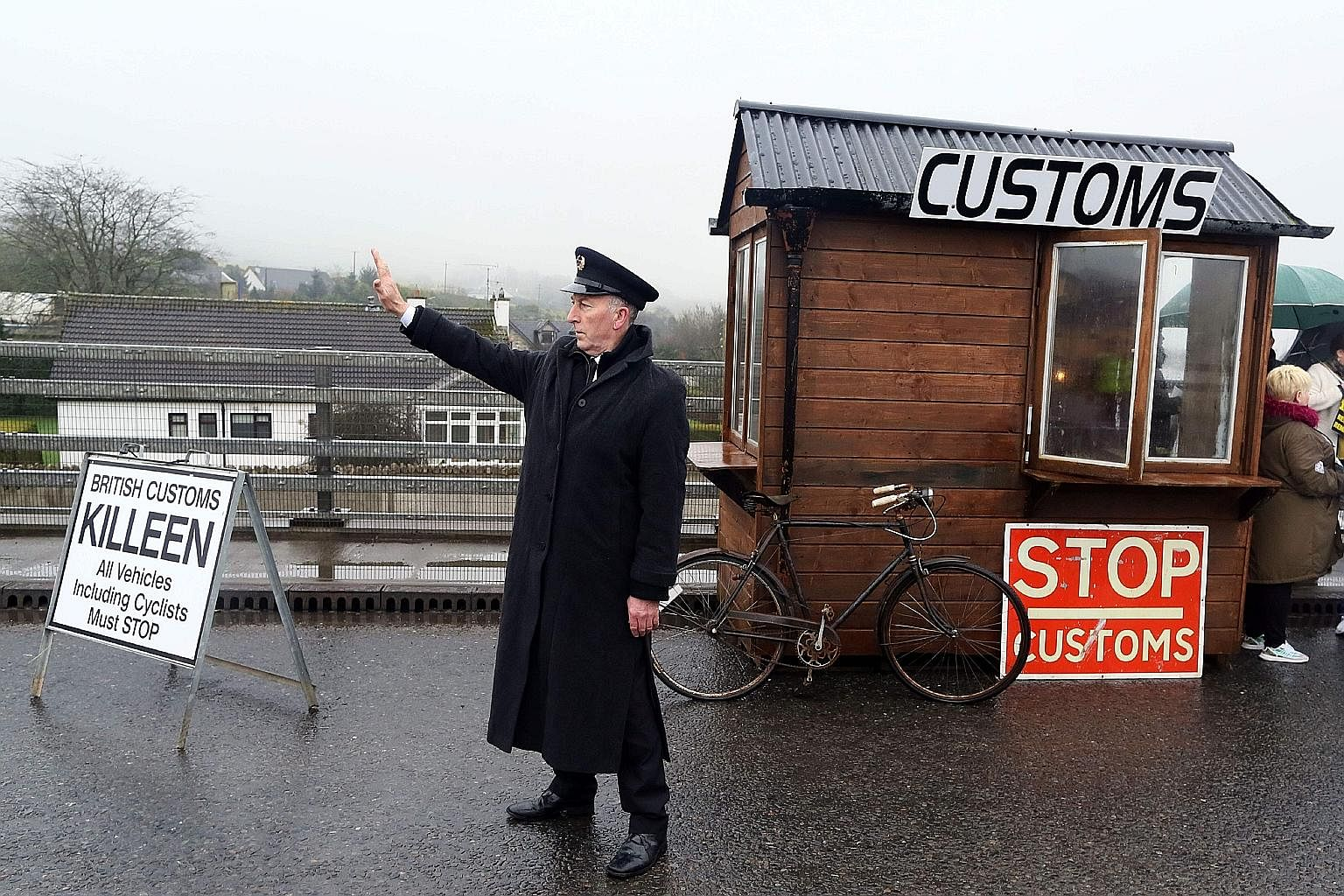 A demonstrator dressed as a Customs official at a mock checkpoint near Dundalk, Ireland, protesting against potential border checks into Northern Ireland following Brexit.