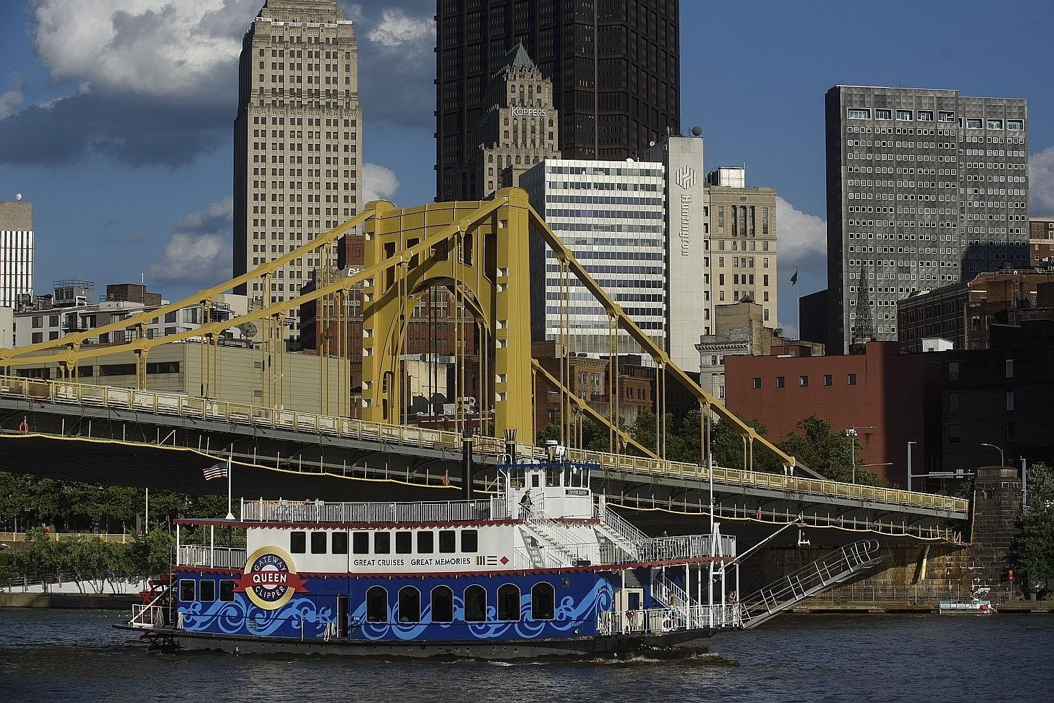 A riverboat plying the Allegheny River in Pittsburgh. Gone are the filthy smokestacks that once dominated the city's skyline. Today, a mixture of shiny new towers and historic old buildings rises above the river, while hip cafes and restaurants have sprun