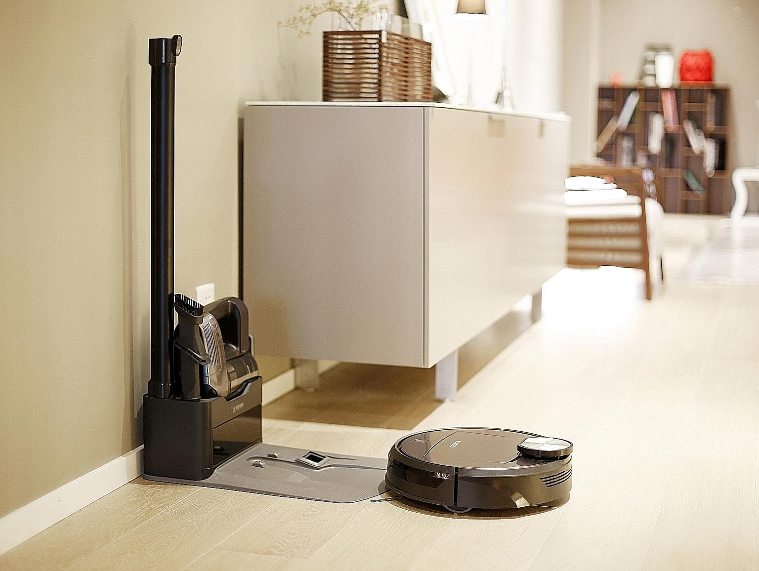 The handheld unit docks at the same charging station as the robot. One great feature is that when the robot docks at the station, it automatically transfers the contents of its bin to the handheld unit's dustbin.