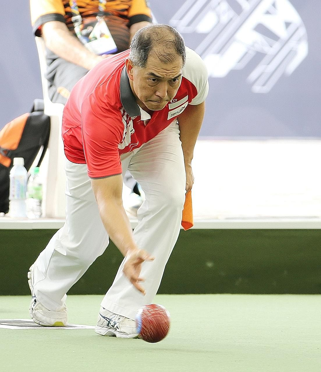 Lee Yuan Min competing in the lawn bowls men's singles final against Malaysia's Muhammad Soufi Rusli. He lost 6-21 but his silver makes him Team Singapore's oldest medallist at the Kuala Lumpur Games.