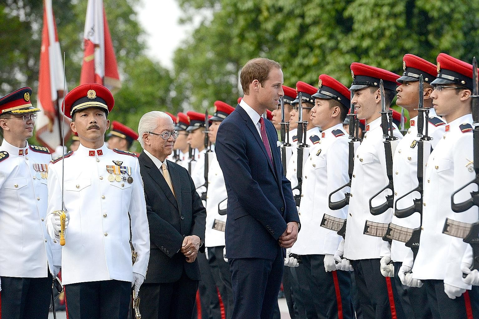 President Tan with (first row, from left) Chinese President Xi Jinping in 2015; Prince William, the Duke of Cambridge, during a welcome ceremony at the Istana in 2012; Brunei's Crown Prince Haji Al-Muhtadee Billah and his wife, Princess Sarahin, in 2