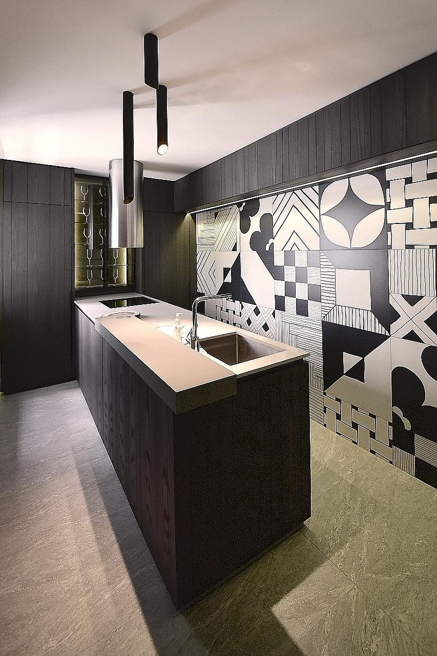 Mr Yeo See Wee and Ms JJ Yip used hand-drawn Italian tiles with busy patterns to create a feature wall in the kitchen.