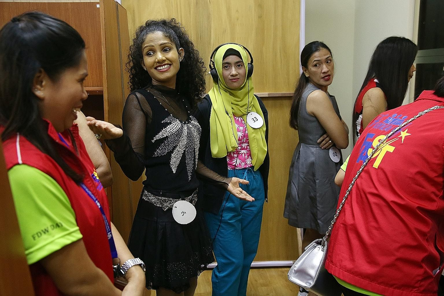Ms Nisansala Anuradhi (in black), 26, from Sri Lanka, preparing to sing solo during a talent contest which drew 117 participants. Finalists will get to perform on the 8th Foreign Domestic Worker Day, which will be celebrated on Oct 15.
