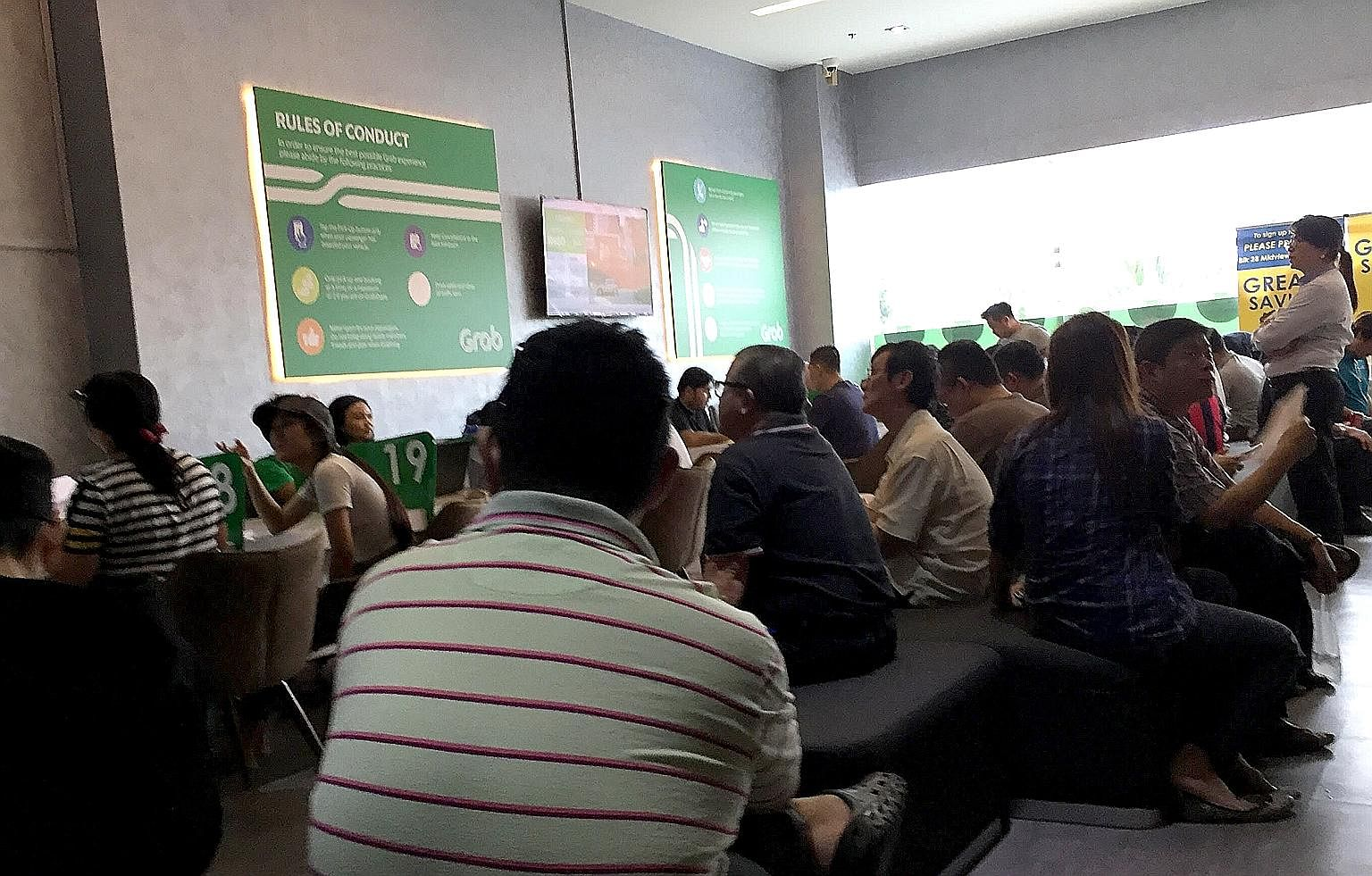 Grab's office in Sin Ming Lane was packed yesterday afternoon with many Comfort and CityCab drivers. At about 2.50pm, the queue number was 473.