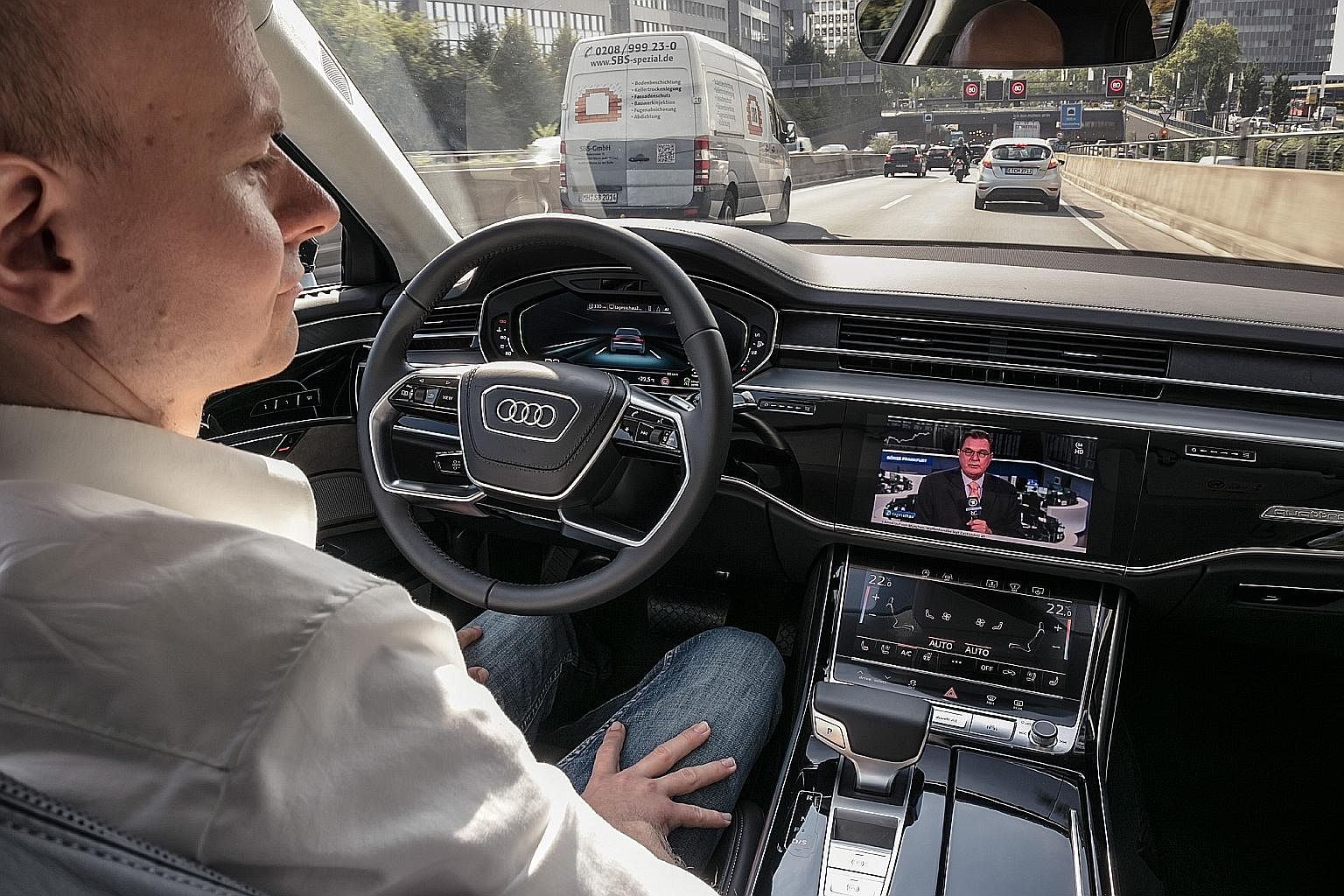 Audi A8's hands-free feature may allow the driver to watch a movie on the car's infotainment screen.
