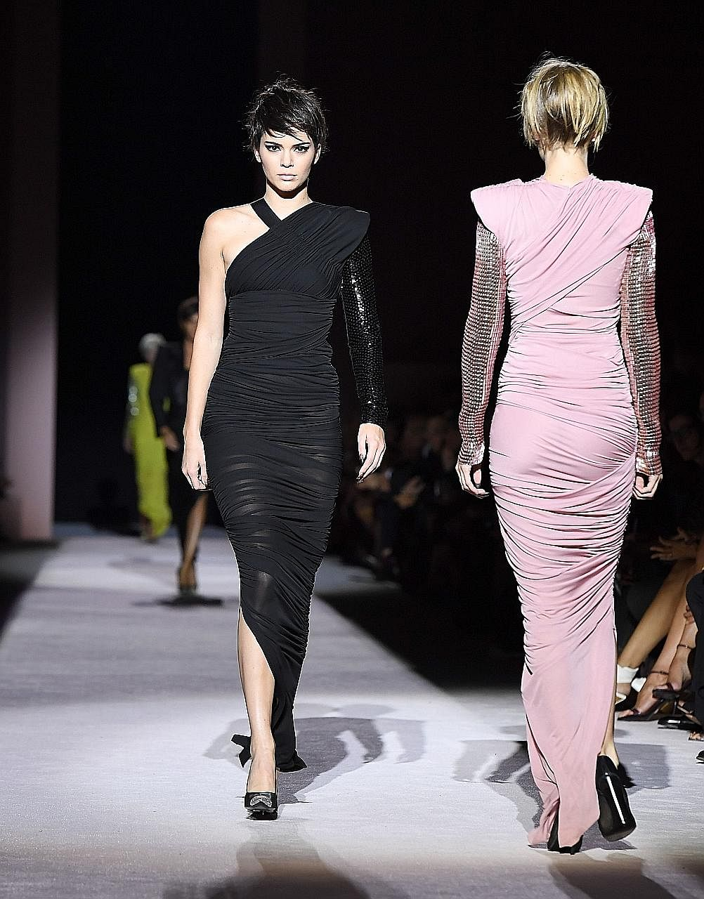 Model Kendall Jenner (above left) on the runway for the Tom Ford show.