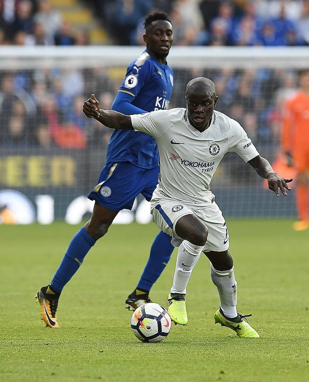 Chelsea's N'Golo Kante holding off Leicester's Nigerian player Wilfred Ndidi during their Premier League game. The France midfielder is going for a hat-trick of Premier League titles, having won the last two with the Blues and the Foxes.