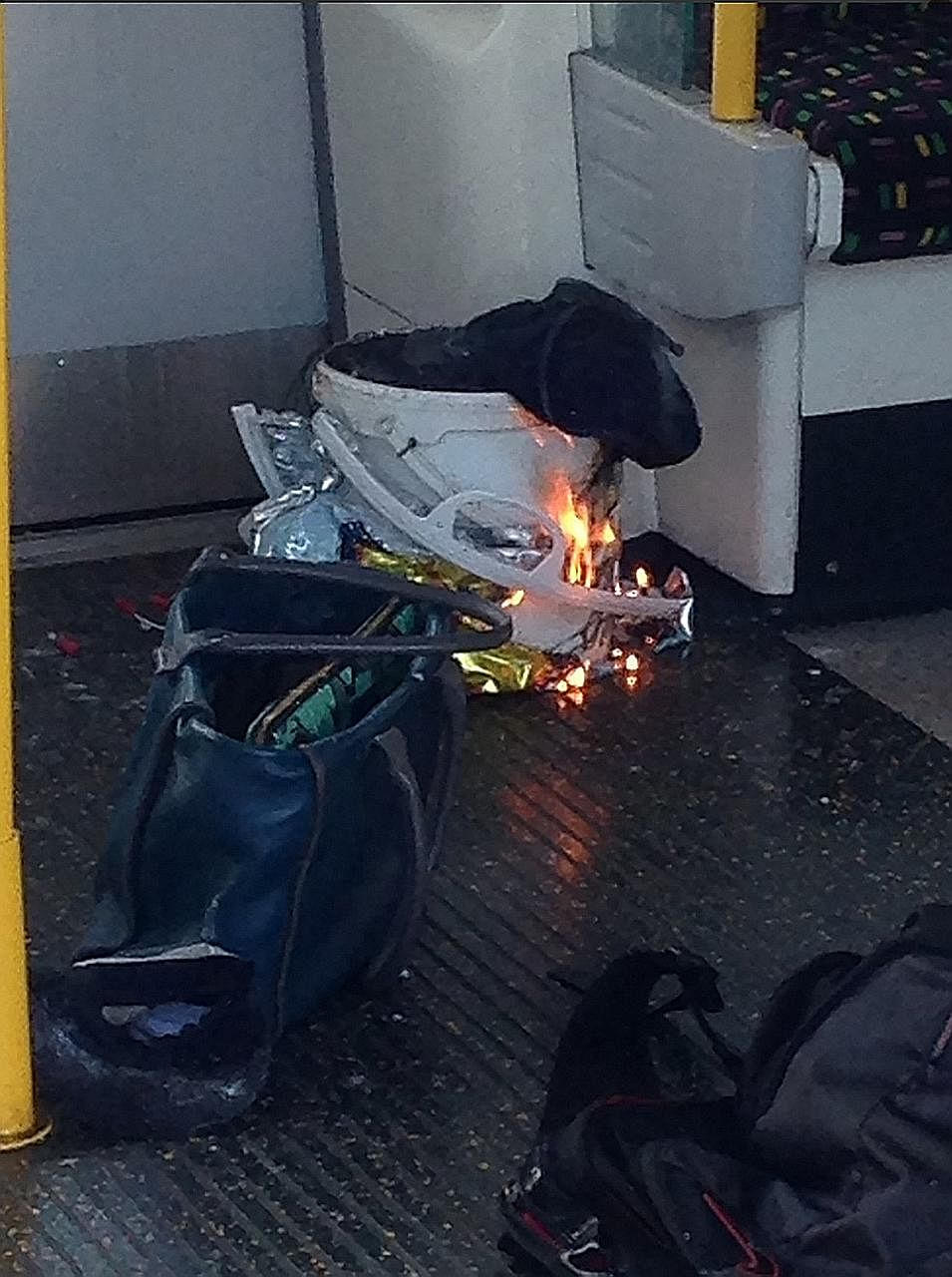 A photo posted by a Twitter user showing a white bucket burning inside the train carriage.