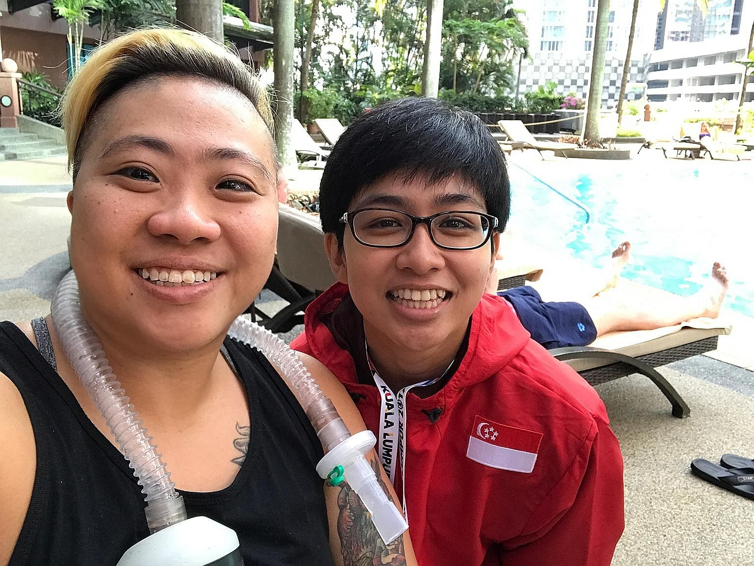 Para-swimmer Theresa Goh, a Paralympic bronze medallist, with Nur Aini Mohamad Yasli, a powerlifter making her Asean Para Games debut.