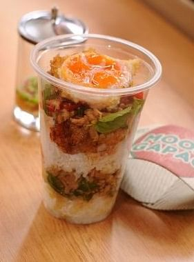 "Moom Gapao's dishes can be ordered in a ""to-go cup""."