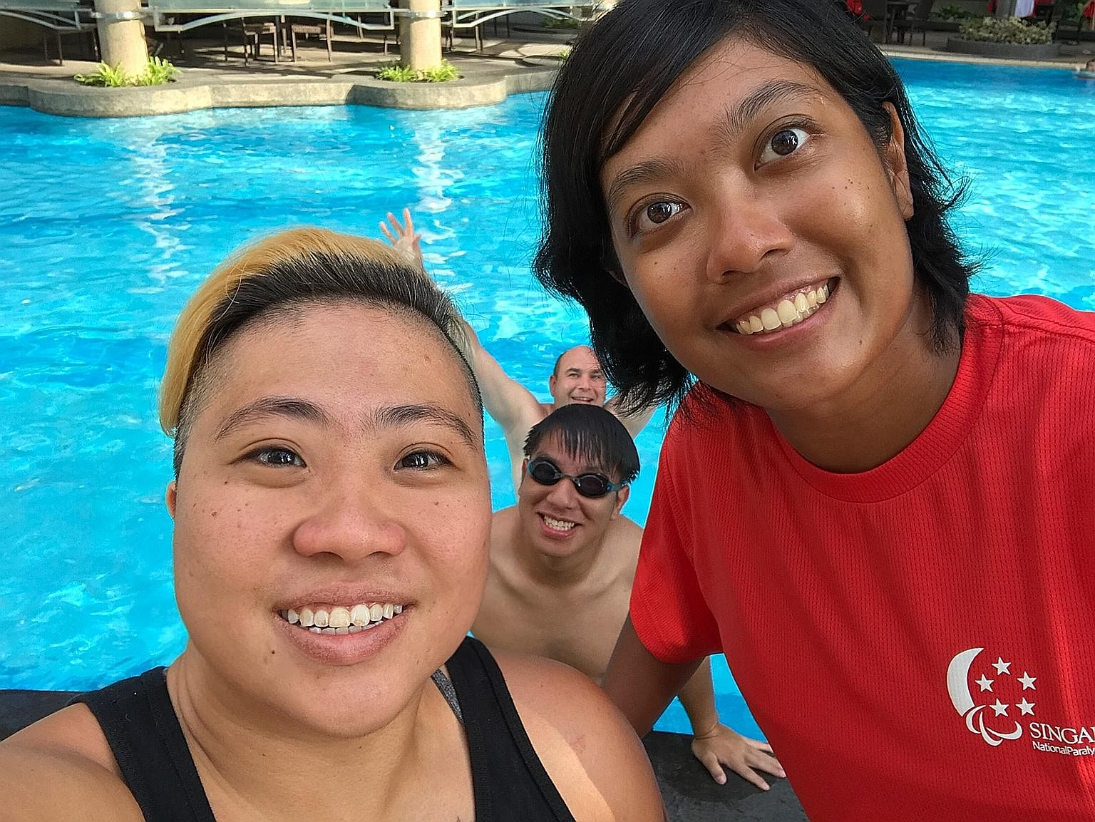 Paralympic swimmer Theresa Goh and para-archer Nur Syahidah Alim chilling out at the pool at the Asean Para Games in Kuala Lumpur.