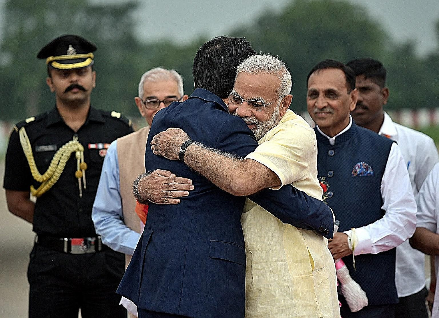 Mr Narendra Modi and Mr Shinzo Abe sharing a bear hug in Gujarat last week - a sign of warm relations between their two countries.