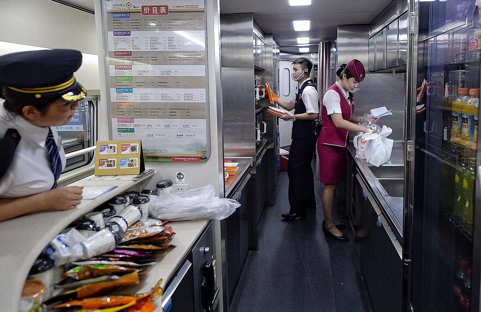 Meals being prepared for distribution at the Shijiazhuang high-speed rail station. Passengers can pre-order meals through the 12306.cn website and app and have their meals delivered to their seats. China's high-speed rail lines are mostly straight wi