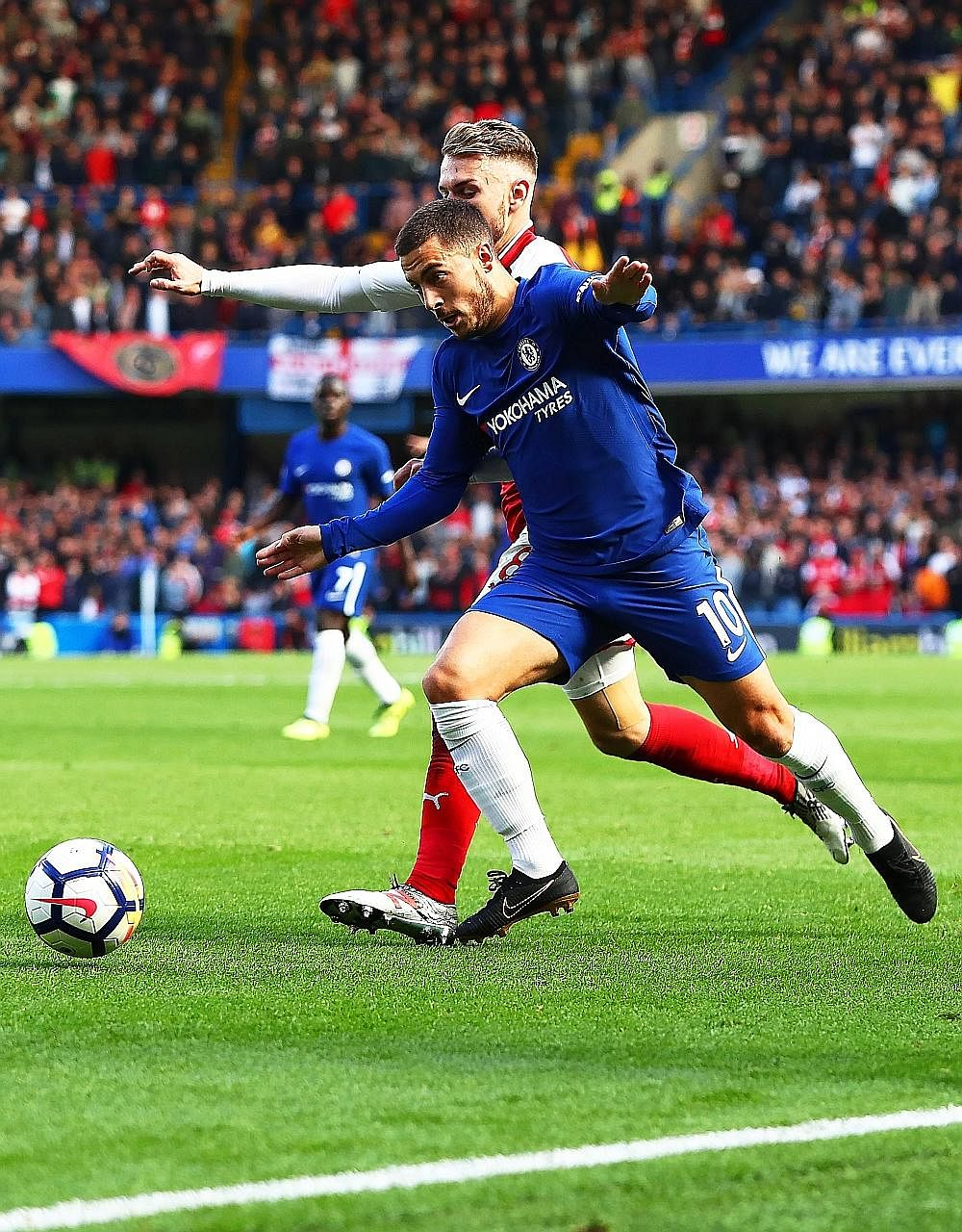 Chelsea forward Eden Hazard (front) fighting for the ball with Arsenal midfielder Aaron Ramsey during an English Premier League match at Stamford Bridge last week. Hazard was a second-half substitute and is still waiting for his first start for the B