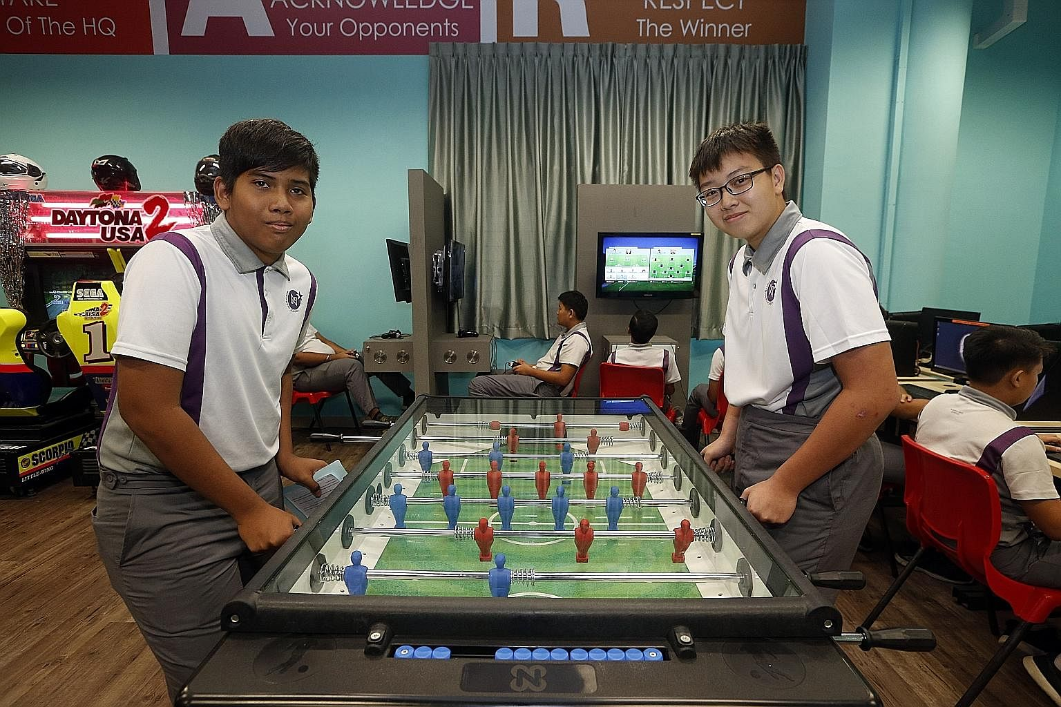 """Singapore Children's Society's Project Cabin, which students have named """"Games HQ"""", has Daytona arcade machines and Xbox games, a pool table and computers."""