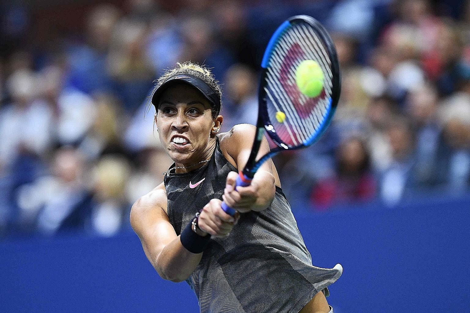 Madison Keys hitting a backhand en route to defeating fellow American CoCo Vandeweghe at the US Open to make her first Major final.