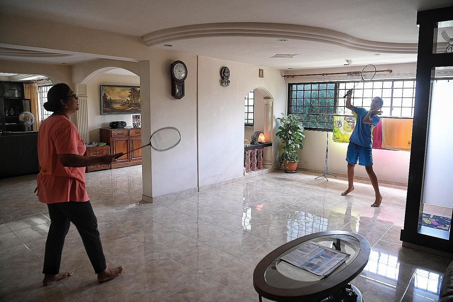 Mrs Indra Rajen in the family's jumbo flat in Yishun, which is spacious enough for a game of badminton with her 12-year-old son, Suneet Rajendraprasad.