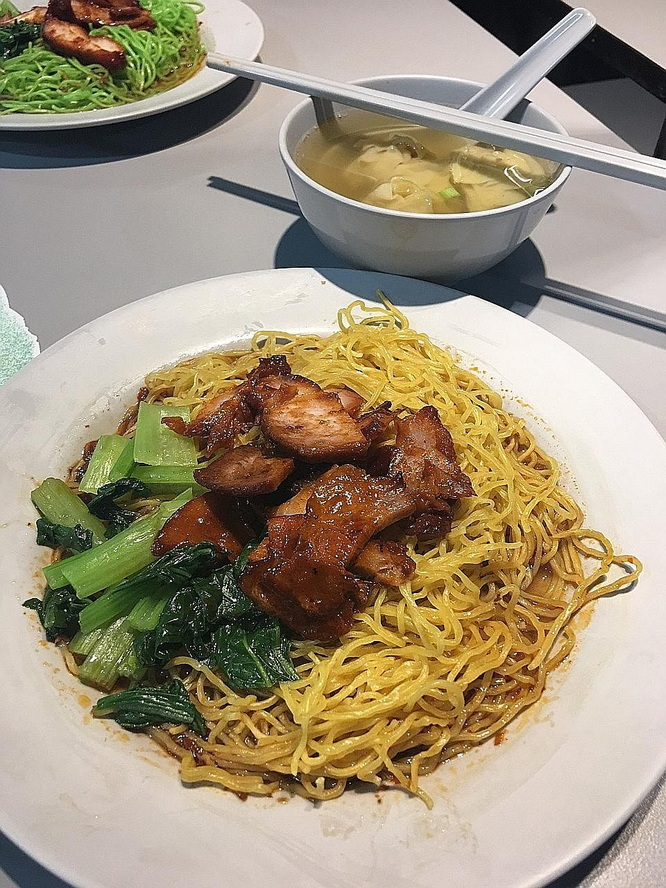 Swee Heng Wanton Noodle's wonton mee comes with thick slices of char siew and juicy boiled dumplings.