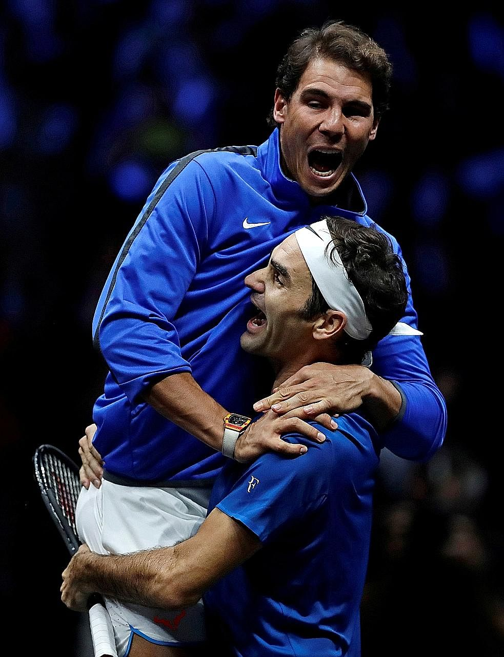 An overjoyed Rafael Nadal jumping into the arms of Roger Federer, as Team Europe celebrate their 15-9 victory over Team World after the Swiss legend beat Nick Kyrgios in the final match in Prague.