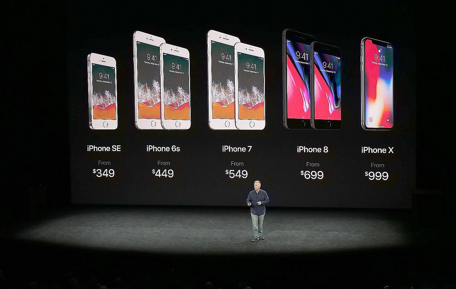 Apple marketing chief Phil Schiller showing the current line-up of iPhones during the special event held at Steve Jobs Theater in Cupertino earlier this month.