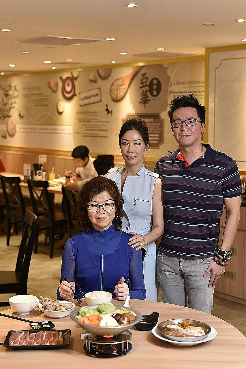 Madam Gwee Peck Hua (seated), founder of Ya Hua Bak Kut Teh, with her daughter Low Hwee Leng and son-in-law Wong Choon Yen and the eatery's steamboat porridge set. Mr Zhong Zhi Xin, co-owner of Ah Tou Seafood Bak Kut Teh, which specialises in the Kla