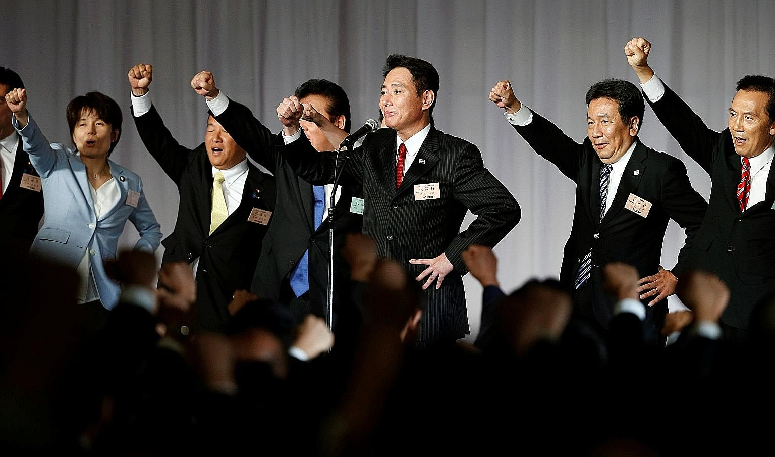 Mr Seiji Maehara with party members after they picked him to lead the Democratic Party, Japan's main opposition group, on Sept 1. Now, DP members say they would rather run as independents than back his tie-up with Kibo no To.