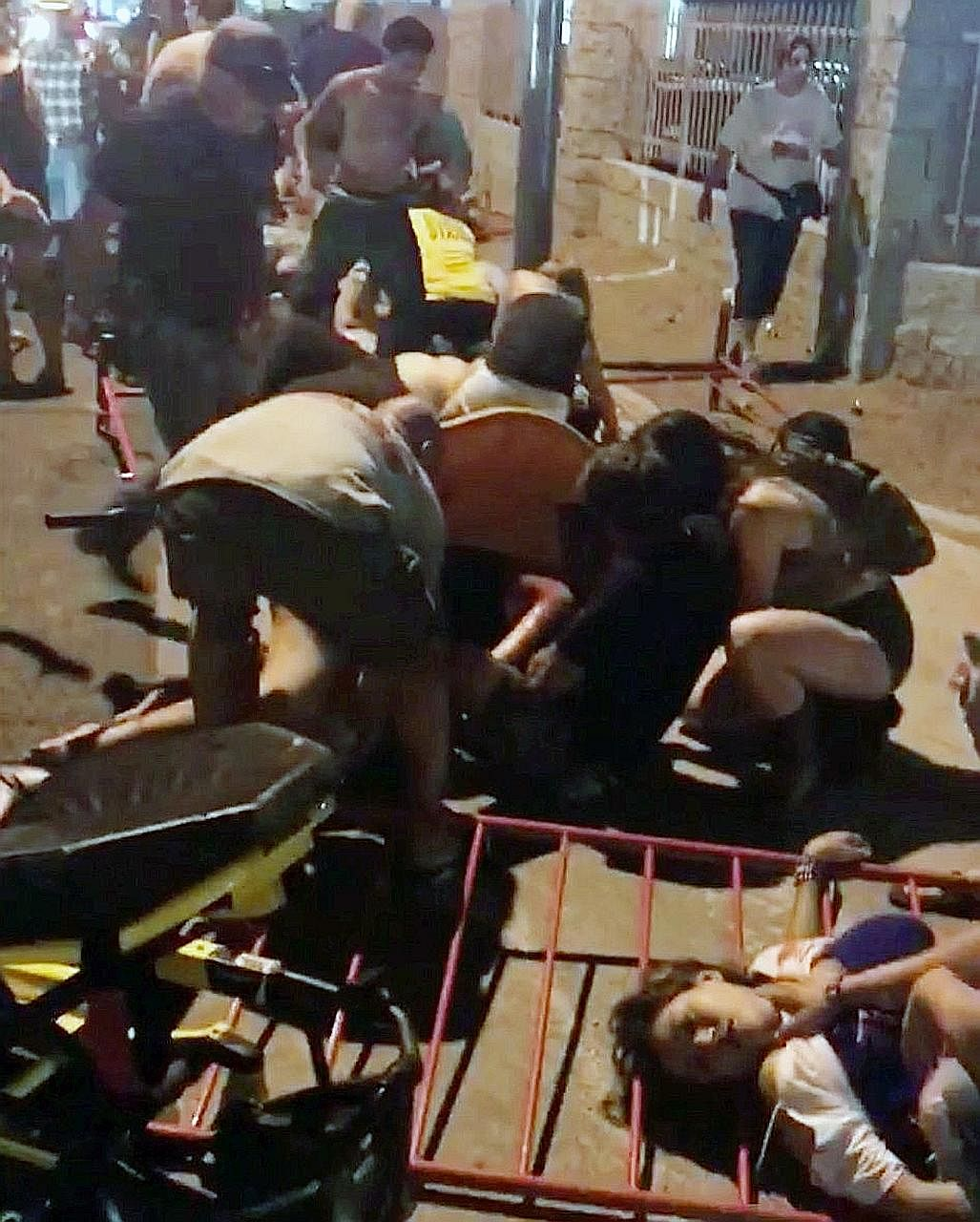 People giving help to those who had been hurt when the shooting began, at the Route 91 Harvest Music Festival in Las Vegas. Some of them became on-the-spot medics, using metal crowd-control stanchions as stretchers, while others turned their private