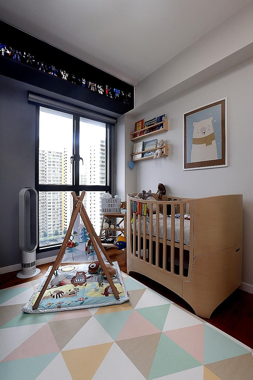 Upcycled wine crates are used as shelves in the living room, especially for the toy collections of home owners Marcus Wong and Gayle Tan (below, with their son, Logan Finn). The nursery (above) and master bedroom (right).
