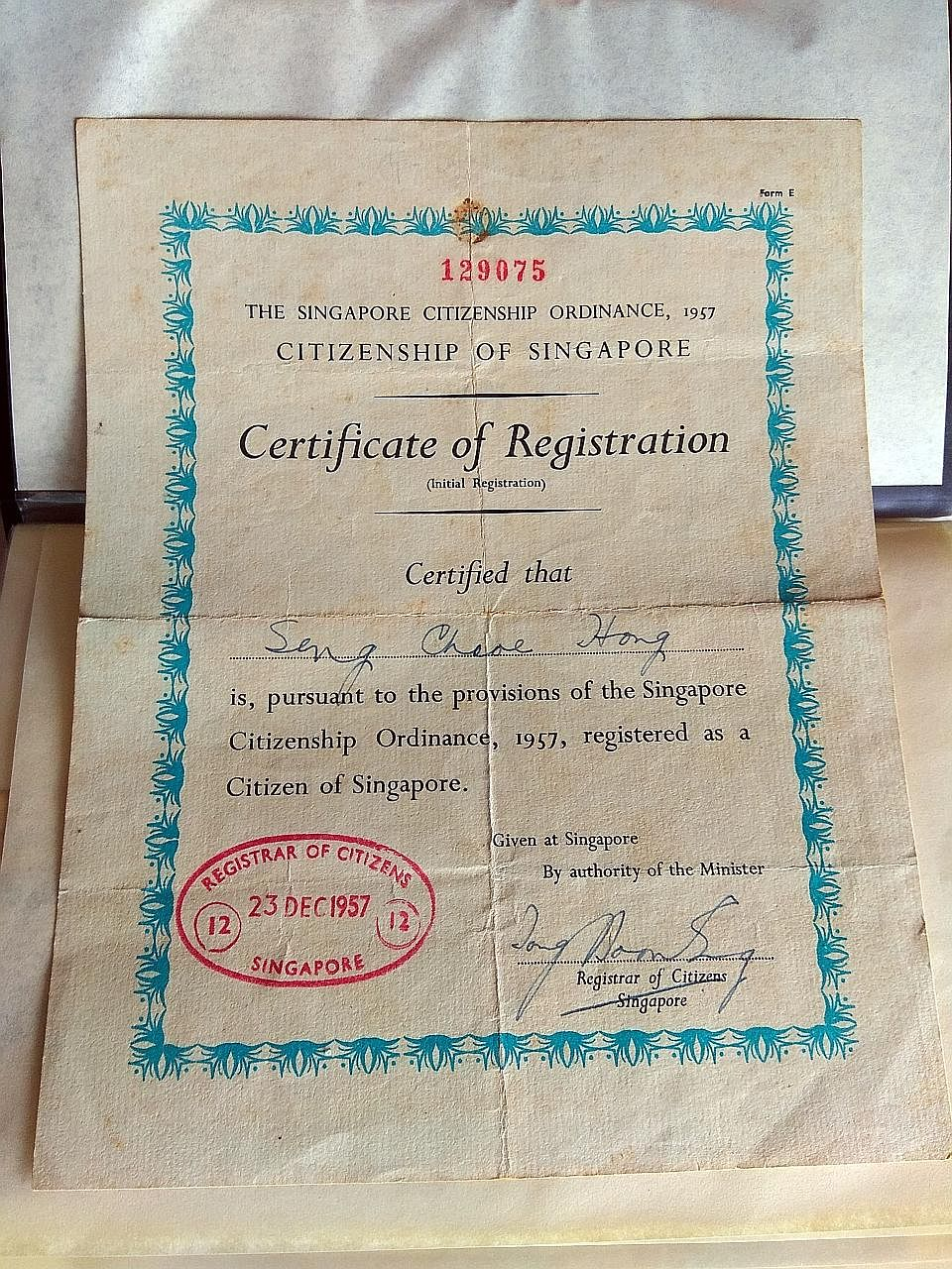 Mr Seng Chek Hong (above) registered as a Singapore citizen in 1957 (left), renouncing his Chinese citizenship. He did so at a time when others from China hesitated, said his grandson.
