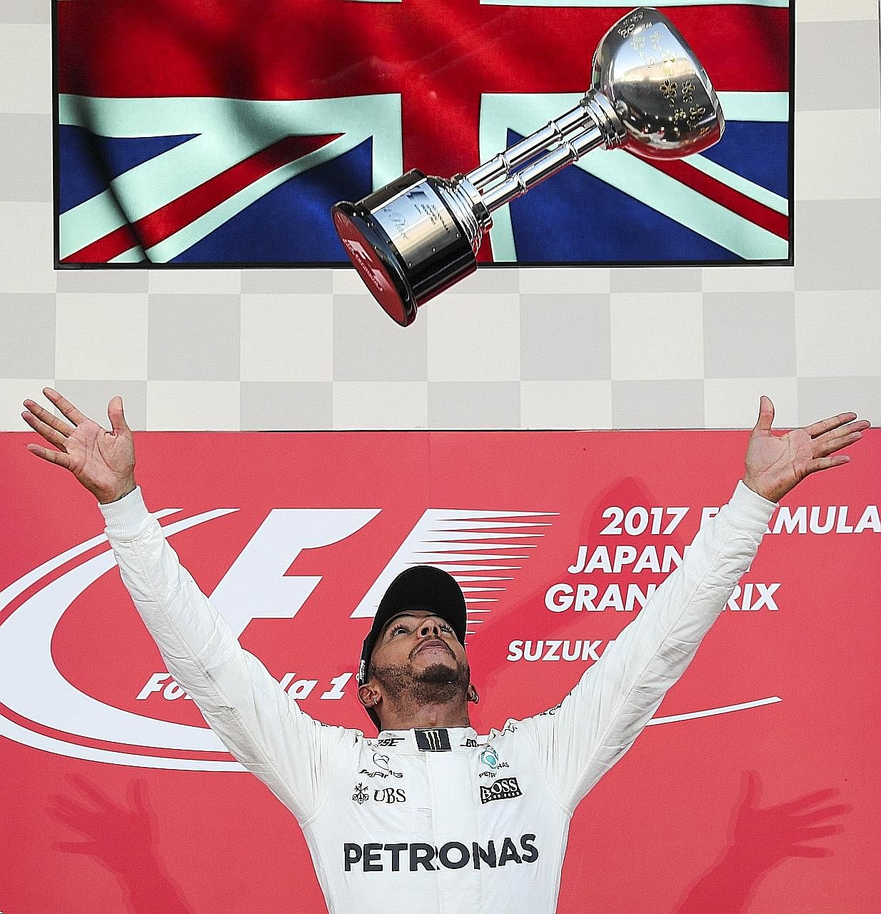 Mercedes' Lewis Hamilton celebrating on the podium after winning the Japanese Grand Prix at the Suzuka Circuit. The Briton has a commanding 59-point lead over his nearest rival.