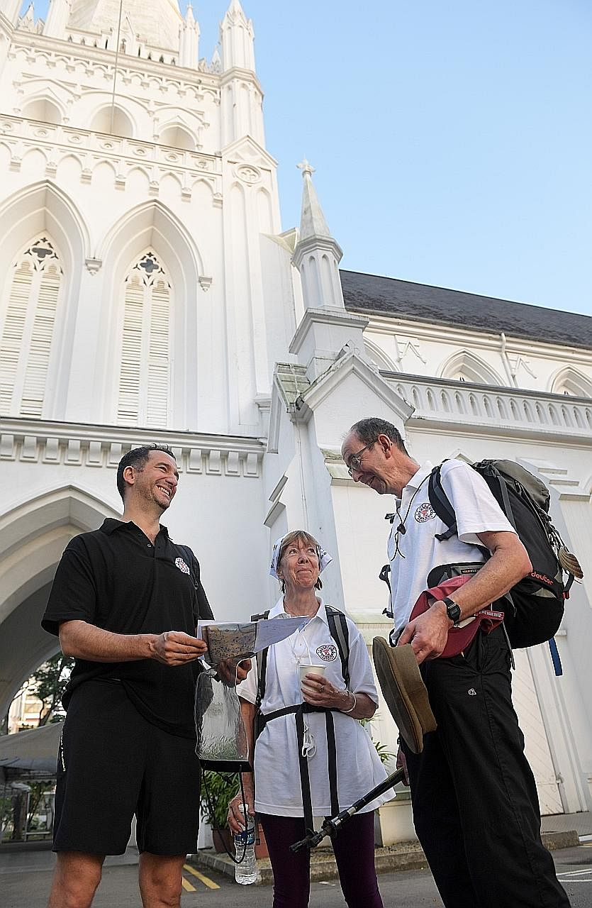(From left) Dr Jonathan Marshall, Ms Villana Murray and Mr Paul Murray at St Andrew's Cathedral last Wednesday. They were retracing Major Francis J. Murray's footsteps by walking 22km from City Hall to Changi Prison, where their fathers - Singapore's