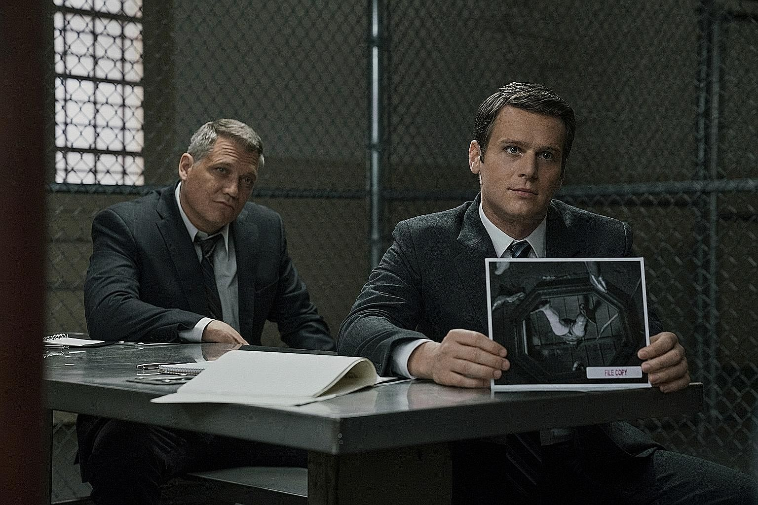 The odd-couple dynamics between Holt McCallany (far left) and Jonathan Groff (left) help keep Mindhunter afloat.