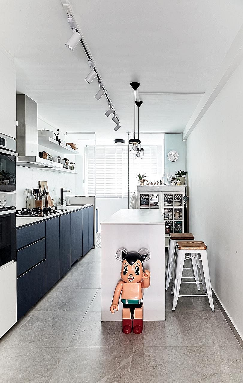 An Astro Boy piece adds a fun, quirky touch to the sleek kitchen.