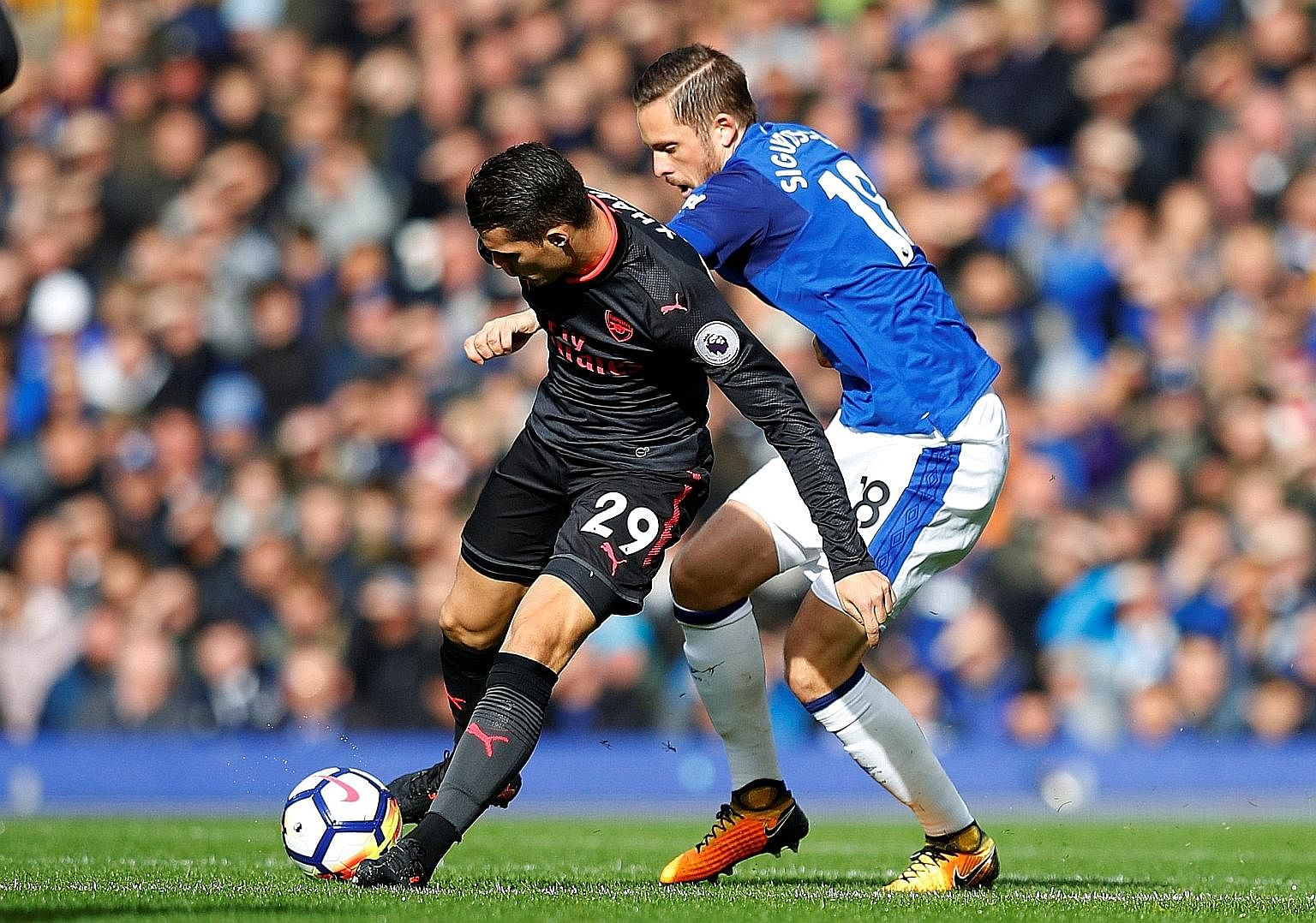 Arsenal's Granit Xhaka outsmarting Everton's Gylfi Sigurdsson during their Premier League encounter last Sunday. The Iceland midfielder, recruited from Swansea City in August, received praise from Ronald Koeman despite below-par performances.