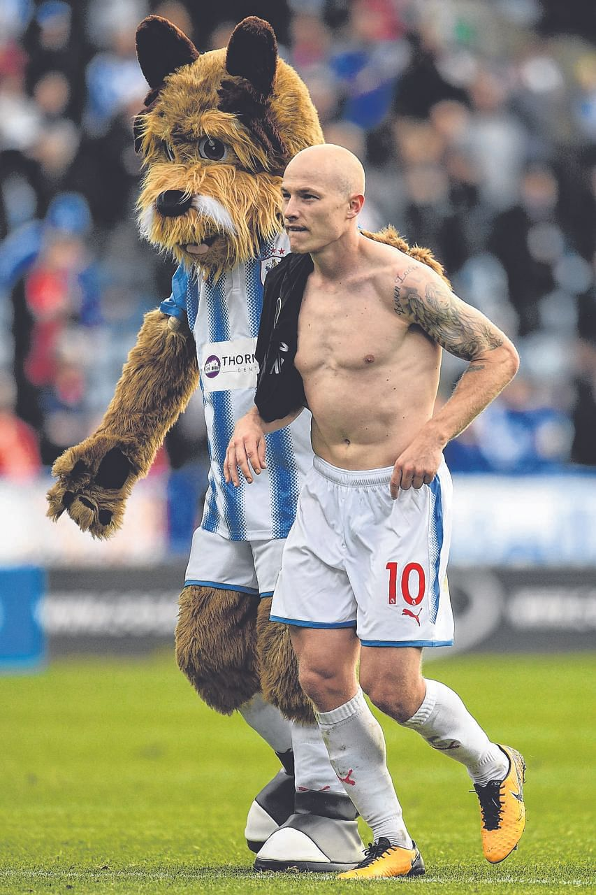 Huddersfield's Aaron Mooy celebrating with the club's mascot after their 1-1 draw with Leicester last month. Liverpool can ill afford to give the 27-year-old Australian space to roam in midfield.