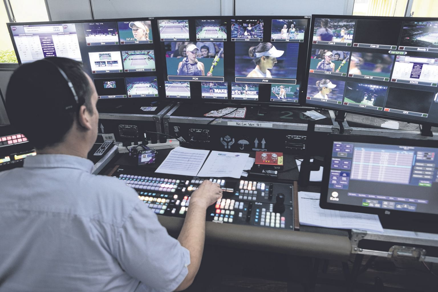 Nic Mills directing the broadcast of the match between Caroline Garcia and Caroline Wozniacki yesterday. The images are beamed to 38 international broadcasters worldwide by a team of over 50 people here.