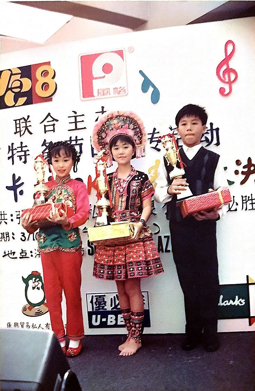 Dong at age seven, in a Chinese princess costume that she wore to sing a song abou